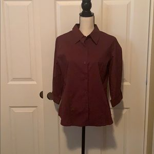 Brown shirt with three quarter sleeves.